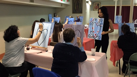 Art students are shown an example of the completed work by instructor Vangie Rodriguez during the art class.