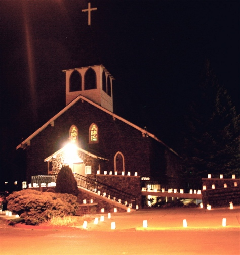 Our Lady of Guadalupe Catholic Church lit up with luminaries prior to the early morning Mass on Dec. 12, 2014 during the Feast of Our Lady of Guadalupe. The luminaries were set up and lit by Flagstaff Nuestras Raíces. Photo by Frank X. Moraga / AmigosNAZ ©2014